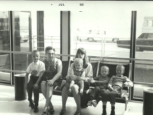 Grandma Pearl and I holding two of my siblings with two more nearby at O'Hare Airport in 1967.